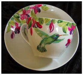 The hummingbird and fuchsia by Xantosia
