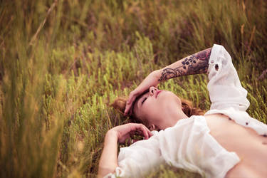 Lying in Grass by jakegarn