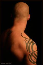 Tribal tattoo by gettincutmuscle