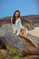 Naya sitting on a rock by yuribrut
