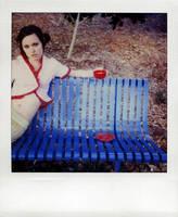 red tea on a blue bench by lloydhughes