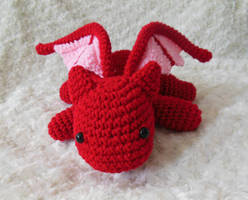 Crochet red dragon front view by StitchedLoveCrochet