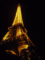 The Eiffel Tower At Night by therampantbookworm