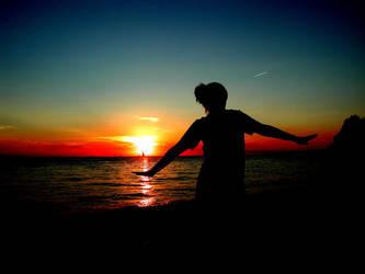 dancing on the beach by NightOfTheNewMoon14