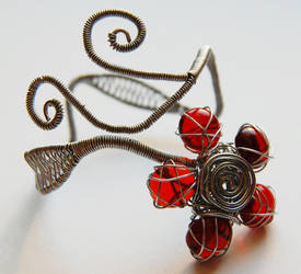 Red flower bracelet by OlgaC