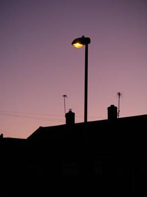 Christmas sunset Street light by simonruddphotos