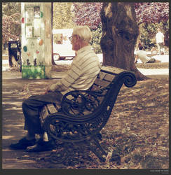 old man in the park by simonruddphotos