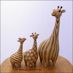 Giraffe Fashion Parade by Hippopottermiss
