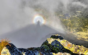 At the top of the mountain - Brocken spectre by miirex