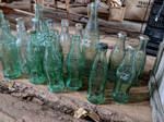 Old CocaCola bottles by Geekophelia