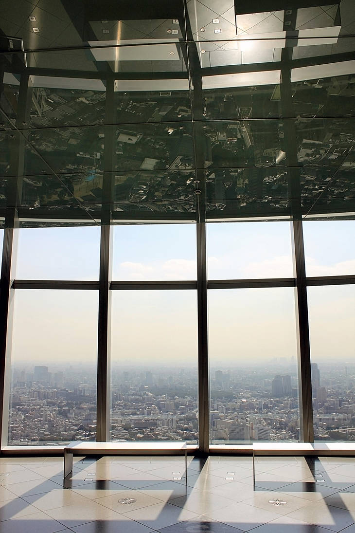 Reflection of Tokyo by Strikethecamera