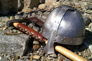 Norse axe and helm in the sun by Durnstaros