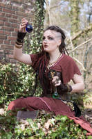 [STOCK] Witch / Shaman looking at a potion glass by rufflesandsteam