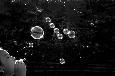 Girl blowing soap bubbles by bingbing51