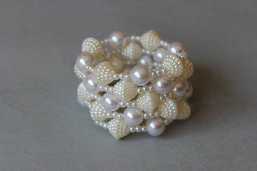 White pearl memory wrap wire bracelet by ettarielart
