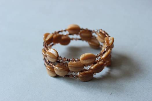 Beige memory wrap wire bracelet by ettarielart