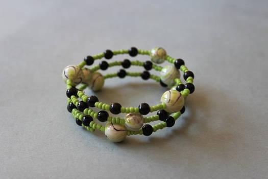 Green and black memory wrap wire bracelet by ettarielart