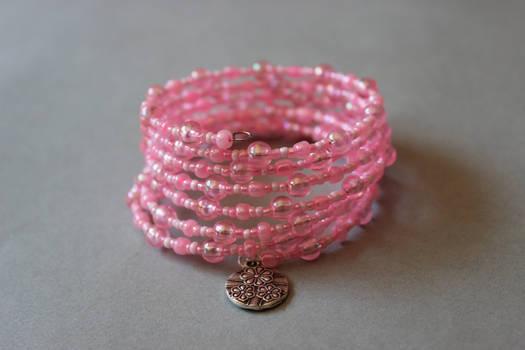Pastel pink memory wrap wire bracelet with flowers by ettarielart