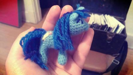 Tiny blue writer pony by terriko
