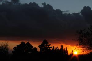 Orange Sunset Illuminating Black Clouds by todaywiththeCJB