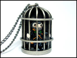 Muzzled Loki in a Cage Necklace by GrandmaThunderpants