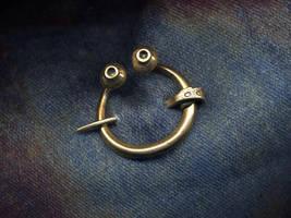 Tiny penannular brooch by Ugrik
