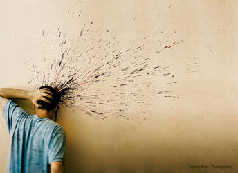 ...the splitting headache... by Teophoto