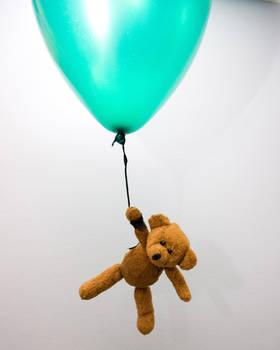 teddy bear flying balloon by doko-stock