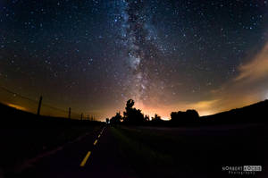Bike path and the milky way by NorbertKocsis