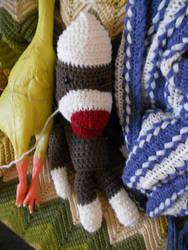 sock monkey.. I guess by Kichisama666