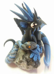 Dragon with a snake by HandmadeDragons