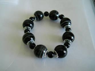 bracelet by crazyemeralddragons