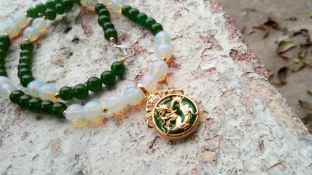 Moonstone and Emerald necklace by WyckedDreamsDesigns
