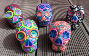polymer clay skulls by tattoopink