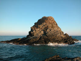 big rock at sea by welder-stock