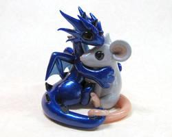 Dragon hugging mouse by DragonsAndBeasties