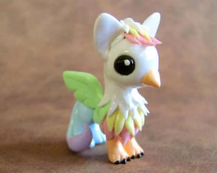 Pastel Rainbow Gryphon by DragonsAndBeasties