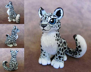 Snow Leopard by DragonsAndBeasties