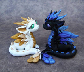Opposites Attract by DragonsAndBeasties