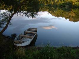 lonely boat by INovumI