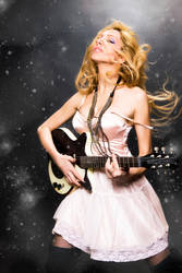 sexy and wild with guitar by AngieStock