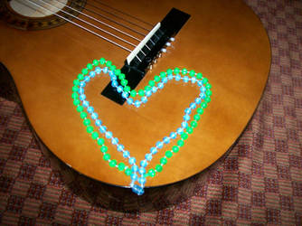 Beads on My Guitar by JmoBaho
