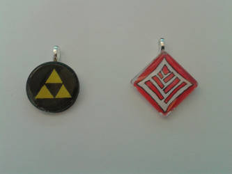 Glass tile pendants - Triforce and Qunari by CeramicHearted