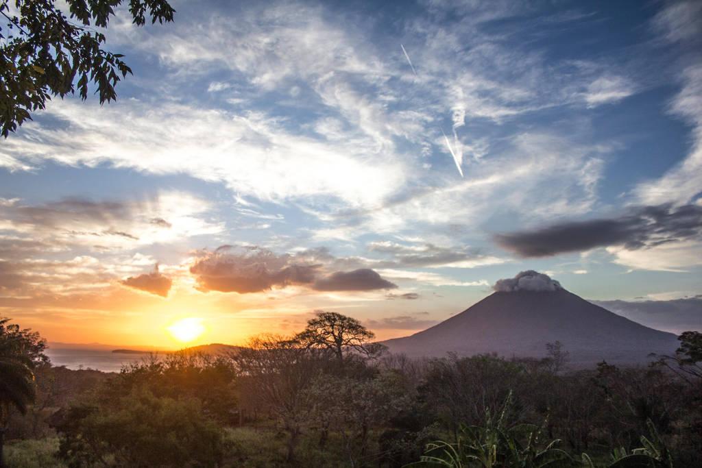Volcano rising by Sliktor