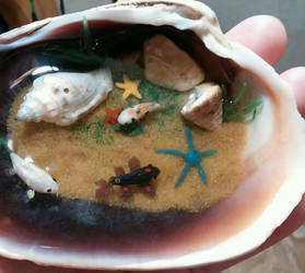 Koi Fish Pond in a Clamshell Ornament by ShadyDarkGirl