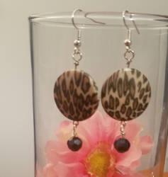Leopard print earrings by FROdominatrix
