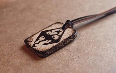 Skyrim - pyrography pendant by Aijoku