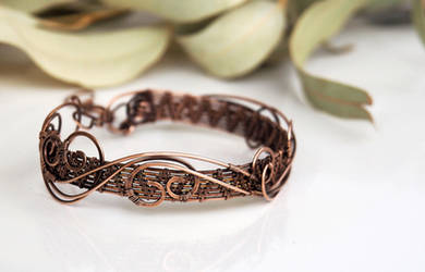 Antiqued copper wire wrapped cuff bracelet by IanirasArtifacts