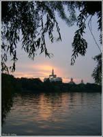 Sunset over the Herastrau lake by Iuliaq