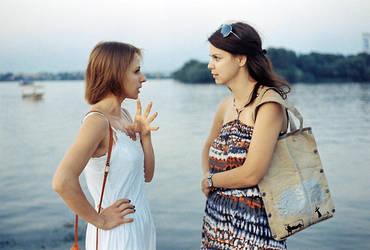 Two women talk by dasuberdog